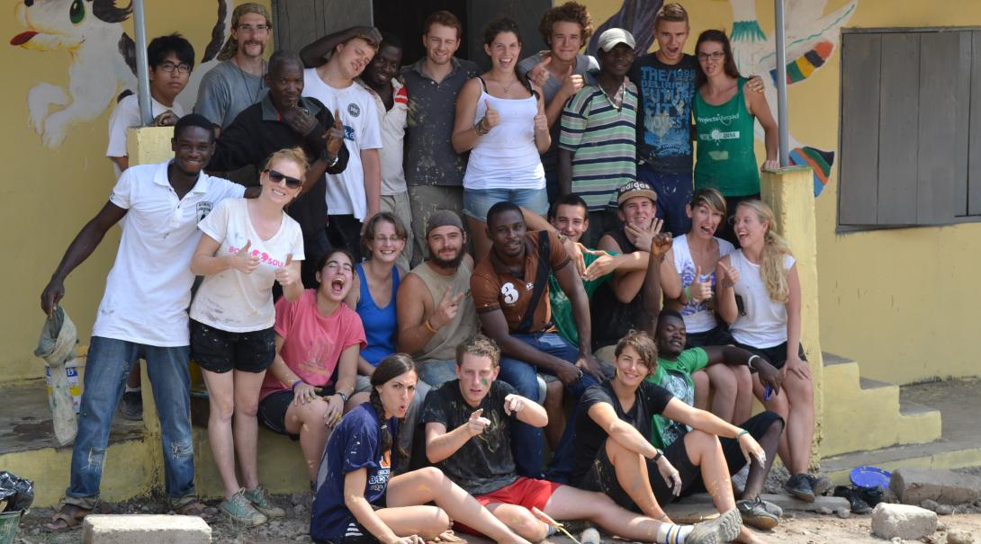 Projects Abroad volunteers are having fun while working on a building project in Ghana during their gap year abroad.